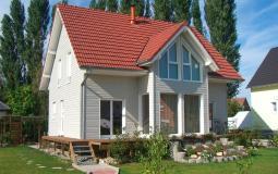 """Modèle de maison bois """"Tilleul"""" avec bardage en bois teinté"""